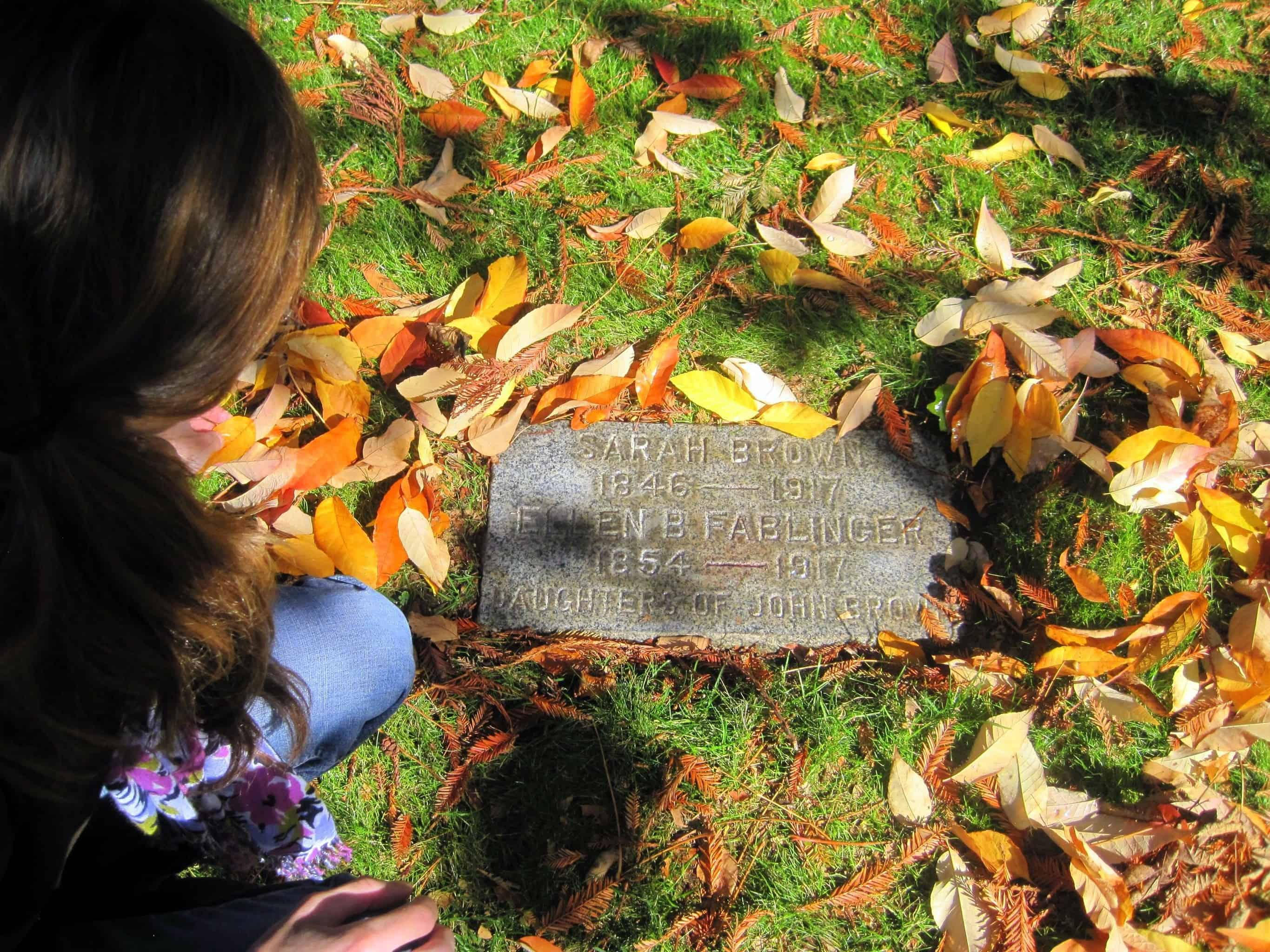 Photo of Author Sarah McCoy at the grave of Sarah Brown. Madronia Cemetery, California.